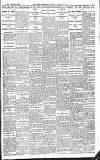 A NEWSPAPER PHOTOGRAPH